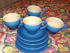 """Never used set of 4 cups & saucers from LE CREUSET. in blue with tan glaze inside. Each cup measures 2 3/4"""" high and 3 1/2"""" across the top. Saucers 6"""" in diameter.   EXCELLENT!! 