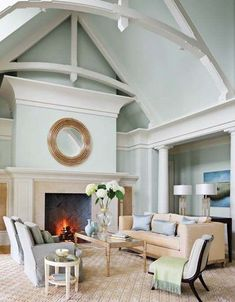 Living room with vaulted ceiling, arched trusses, and oversize cove molding .
