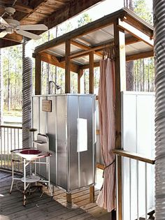 This galvanized metal outdoor shower enclosure looks right at home in this vacation spot created from an old grain silo. Surrounded by miles of farmland, this alfresco shower has plenty of built-in privacy.