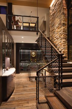 Beautiful sculptural staircase above the wine cellar.