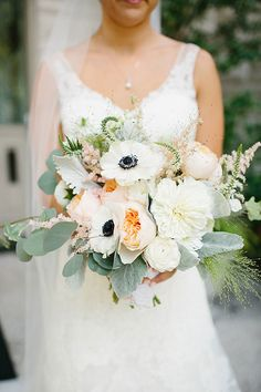 Loose Bouquet of Garden Roses, Ranunculus, and Anemones | Brides.com