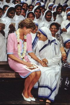 Princess Diana held hands with a nun at Mother Teresa's hospice in Calcutta during her visit to India in February 1992.