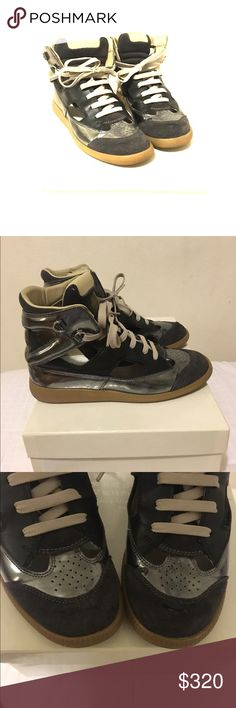 Maison Martin Margiela Women's Cutout Sneakers Maison Martin Margiela Women's Cutout Suede & Leather High-Top Sneakers size uk 7 US 8 EU 41. Authentic. Worn two times. As shown the right sneaker has minor damage to them. However, the rest of the sneakers are intact. Comes with original box. Maison Martin Margiela Shoes Sneakers