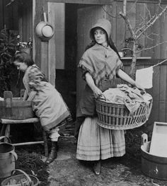 A Victorian woman and young girl hard at work on the family's laundry, 1870s.