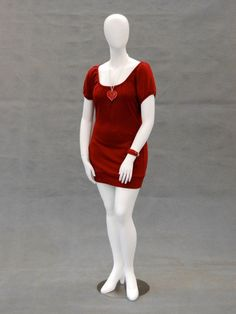 Nancy is a plus-size female egg-head style mannequin in a matte or glossy white finish. Nancy is in a standing pose with her arms in front of her legs. She has a high heel feet feature; includes a met