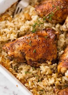 Close up of Baked Chicken and Rice in a white baking dish fresh out of the oven