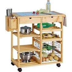 Wheeled kitchen island, extra worktop when u need it, wheels away when you don't. Extra storage space as well. As  I'll never have a kitchen big enough to get a proper island