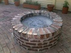 Image result for round outdoor brick braai