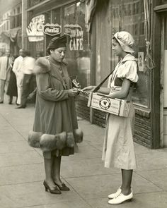 1940s photo of a Beech-Nut Gum Girl in front of the Little Savoy Café.  I love her super puffy sleeves!