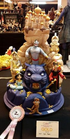 "Gold Medal and 2º Best Gold in the Category ""Decorative Exhibition"" on Cake International Birmingham, 2014 - Work - ""Aladdin and Jasmine Love Story"""