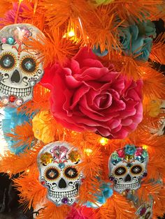 Day of the Dead inspiration for your Halloween tree! See how @cathiefilian decorated the 100% Orange Christmas Tree with DIY sugar skull ornaments and vibrant flowers.