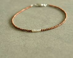 Tiny pearl bracelet, African copper beads, sterling silver, minimalist small bead bracelet, white genuine tiny natural seed pearl bracelet  https://www.etsy.com/shop/bluegreenjewels