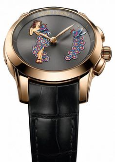 The Ulysse Nardin Hourstriker Pin-Up (shown in rose gold with black leather strap) is one of the brand's chiming watches with jaquemarts — tiny automatons mounted on a watch dial that strike the hours on a bell. It is limited to just 28 pieces and contains an automatic movement, Caliber UN-610. More @ http://www.watchtime.com/wristwatch-industry-news/watches/ulysse-nardin-classico-manufacture-grand-feu-and-hourstriker-pin-up/ #ulyssenardin #watchtime #horology #SIHH2017