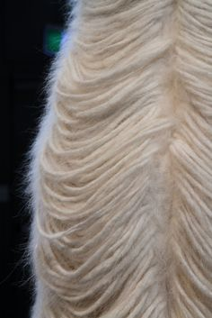 KINDEKINDER AGGUGINI F/W 2010 detail. this gives me an idea: make fringes out of woolen knitting ball!