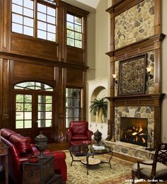 This fireplace is a striking focal point for the great room! The Hollingbourne - Plan 990.  http://www.dongardner.com/plan_details.aspx?pid=2670. #Fireplace #GreatRoom #Design