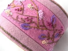 Hand Embroidery Fabric Textile Wrist Cuff pink pastel Wildflower Romance Bracelet Featured In CrossStitch and Needlework.