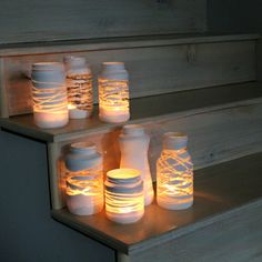 + Ideas for Beautiful and Ingenious Mason Jar Crafts mason-jar-decorations-seven-jars-of-different-shapes-and-sizes-decorated-with-white-paint-containing-lit-candles-placed-on-wooden-steps Diy And Crafts Sewing, Crafts To Sell, Fun Crafts, Candle Lanterns, Diy Candles, Mason Jar Crafts, Mason Jar Diy, Craft Wedding, Diy Crafts Videos