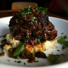 red wine braised beef short rib with smashed potatoes, cremini & porcini mushrooms, gremolata
