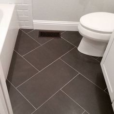 12x24 Tile Bathroom Floor. Could use same tile but different design on shower walls (not this exact tile but this shape & size).