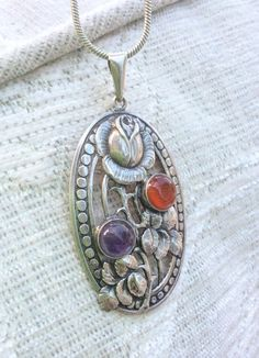 Hey, I found this really awesome Etsy listing at https://www.etsy.com/listing/220046719/art-nouveau-pendant-arts-crafts-pendant
