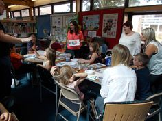 Families making bracelets with Jewellery designer Katherine, at Duston Library.