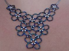 beaded flowers necklace - but not joined with rings, but directly, like the butterfly necklaces