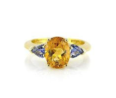 An 18ct Yellow Gold, Citrine and Tanzanite Ring