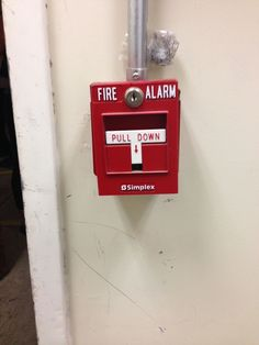 this is a fire alarm in case of fire pull down to sound alarms