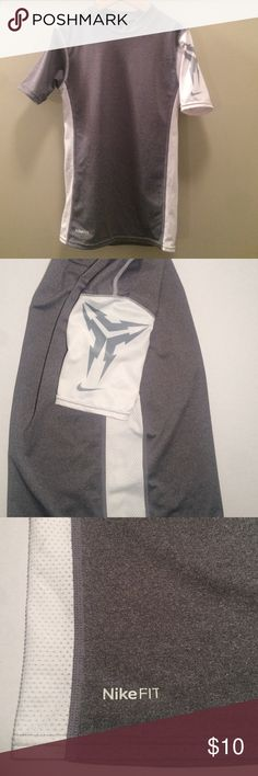 """Nike FIT DRY shirt This grey and white Nike FIT DRY shirt is in good used condition. It has white mesh side panel stripes. The left sleeve has a print detail. This is a size Medium and measure approximately 11.5"""" across and 20"""" from shoulder to bottom hem. Nike Shirts & Tops Tees - Short Sleeve"""