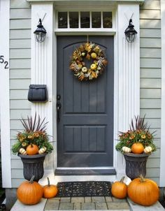Front door with windows above and trim. Fall decorating..symmetric entrance with transom, pumpkins and planters..pretty! by kris.grable.9
