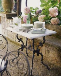 This would make a great table for a small patio. You can use the old sewing machine base and get a top made. There are so many scraps of granite and marble out there today that it would be fairly inexpensive for the top.