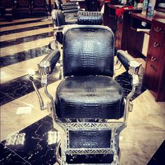 Refinished Takara Belmont barber chairs in Ray's Barber Shop NYC.