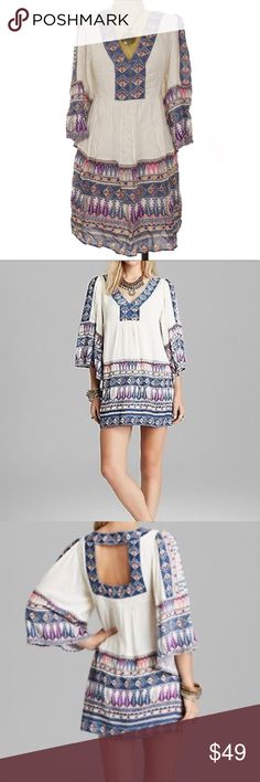 "NEW Free People Terra Nova Tunic Ivory Midi Dress New with display tag (not Free People tag) Free People Terra Nova Printed V Neck Ivory Tunic Dress  ORIGINAL ITEM IS ON MANNEQUIN in FIRST PHOTO V neck. Bust 18.5""across (Laying flat) 3/4 sleeve. Length appx 35"" Color Ivory Slate blue and plum Print on front & back . Zipper on side for perfect fit. Gather on front & back.	 Fabric Rayon Free People Dresses Midi"
