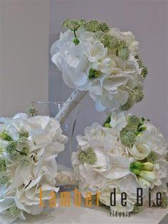 white wedding flowers Pure white Hydrangea flowers, White scented Freesia, White Lisyanthus frowes (Eustoma) and white Astrantia.