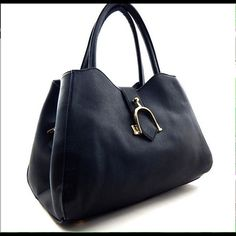 """Super Cute Satchel This medium vegan bag features gold tone hardware, optional adjustable strap, fully lined inside with pockets, closure, snap button, interior has one center divider, with zipper pocket, 2 slip pockets,one exterior zipper pocket, 7"""" drop handles. (This closet does not trade or use PayPal ) Bags Satchels"""