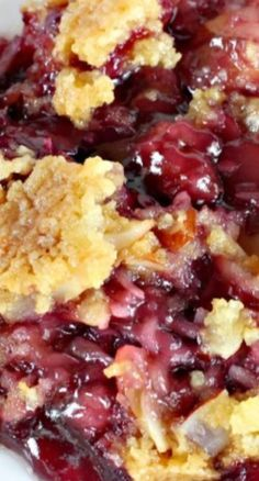 TEXAS COBBLER ~~~ Spectacular dump cake-type dessert using blueberry and cherry pie fillings, crushed pineapple, almonds and coconut. Great for holiday entertaining and potlucks.