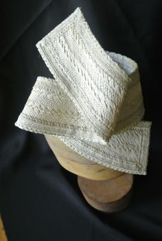 Fascinator hat made from vintage straw trimmed with vintage lace.