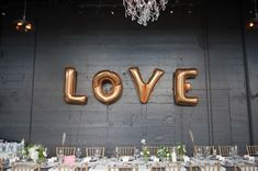 LOVE mylar balloon ideas - photo by Jarusha Brown - http://ruffledblog.com/black-gold-calgary-wedding/