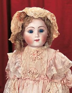 """*VERY RARE FRENCH BISQUE BEBE, SERIES E ~ by: Jules Steiner, 24"""".  Bisque socket head, very plump cheeks w/long-faced modeling, rounded blue glass paperweight inset eyes w/spiral threading....MARKS: Sie E 5. Comments: Jules Nicolas Steiner, early 1880's.....Theriault's Antique Doll Auctions"""