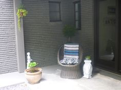 the other side of the porch.  Wicker chair from a 2nd hand store painted (washed) gray.  Throw from Goodwill.  Elephant was a thrift find.  Statue a gift from our neighbor