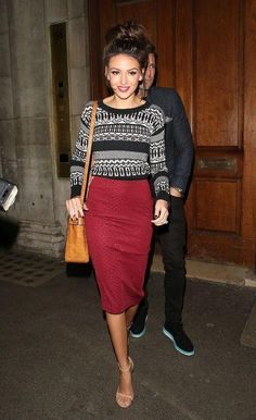 Michelle Keegan in a red pencil skirt and black and white sweater