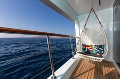 Perhaps a reflection of their youthful age, the owners of Ocean Paradise wanted a chair swing on the master suite's balcony. They also wanted a fixed balcony, not one formed by a fold-down bulkhead. This way they can enjoy the view whether at anchor or while Ocean Paradise is cruising at 12 knots.