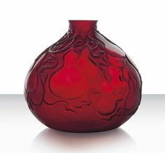 R. LALIQUE (1860-1945)___. 'Courges' Vase, No. 900 designed 1914 - cherry red and white stained 7 ¼ in. (18.4 cm.) high | intaglio