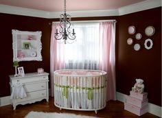 non traditional nursery. LOVE the wall color and the chandelier!