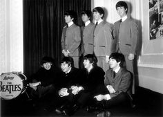 The Beatles left to right: George Harrison, John Lennon, Ringo Starr and Paul McCartney sitting in front of their waxworks at Madame Tussauds in London. April 1964