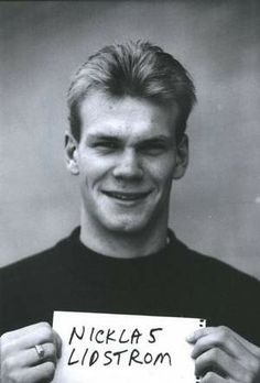 "Nick Lidstrom holding a piece of paper with his name spelled correctly. For his first season with the Wings, it was spelled as ""Niklas"" in the media guide."