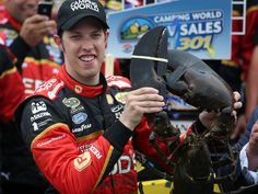 Brad Keselowski celebrates in victory lane with a lobster after winning the Camping World RV Sales 301 at New Hampshire Motor Speedway on July 13, 2014.