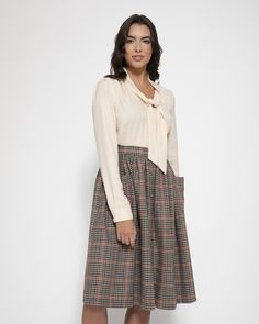 'Adalene' is back and available in a rustic check design. Perfect for the upcoming Autumn season. A must have addition to your wardrobe. Tweed, Swing Rock, Purple Cardigan, Swing Skirt, Models, Retro Look, Material Design, Vintage Skirt, Flare Skirt