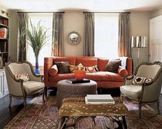 living room federal mirror taupe & orange metallic lampshade. Please mentally erase the deerskin covering the ottoman in the foreground!