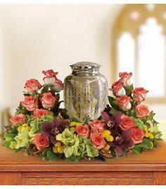 A wreath of flowers around Mom's urn